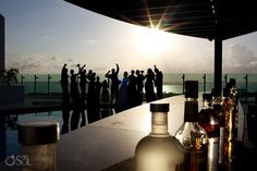 Wedding reception cocktail time at @prweddings Beach Palace Resort in Cancun. Mexico wedding photographers Del Sol Photography.