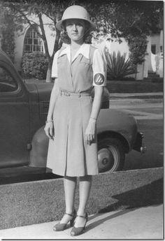 Air Raid Warden during WWII.  1943, Los Angeles/Hollywood area.  When the air raid sirens sounded, she walked the neighborhood, making sure people had their lights off.   If any light showed from any window, she had to knock on their door and tell them.