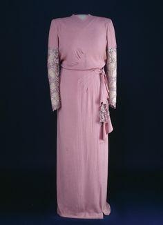 Eleanor Roosevelt wore this pink rayon crepe gown trimmed with lace and sequins to the 1945 inaugural reception. It was designed by Arnold Constable.