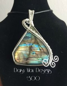#300 - Labradorite - wrapped in solid sterling silver. Hand made wire wrapped pendant necklace jewelry