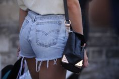 """simple chic street fashion styles using the handbag as the structural """"chic"""" element"""