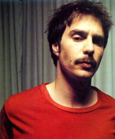 Sam Rockwell. That's right, he's got a mustache, just try to make fun of him!! You can't, because he's so fuckin awesome!
