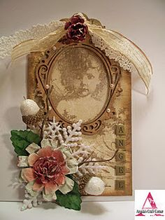 tag with frame, flower/leaves, white acorns.  Background oval frame; tan colors
