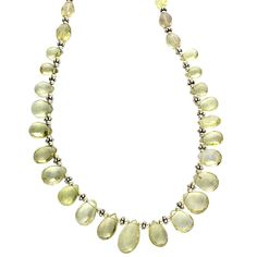 """Lemon Quartz Sterling Silver 16 Inch Teardrop Necklace with Extension. * 16"""" with 1 1/2"""" extension, Lemon Quartz necklace * 21 faceted briolettes * Large lobster clasp * Hand crafted and faceted (expect variation in color and size) * Stamped 925 * Weight: 22.8g (approx) * This item is suitable for all occasions, holidays and for personal use * Product is shipped in cotton filled presentation box * TG#N021."""