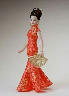 """Manufacturer's catalog image of 18"""" vinyl Year of the Dragon Kitty Collier dressed doll, United States, 2002, by Robert Tonner."""