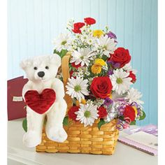 Experiment The True Power Of Love When You Give This Colorful And Beautiful Basket To Your Loved One. Beautiful Combination Of Mix Flowers Like Daisies, Roses And Gerbera Daisies, Arranged In A Delicate Wicker Basket, With A Romantic Teddy Heart Bear Approximately 40 X 35 Cm. Teddy Bear Online, Buy Teddy Bear, Animal Delivery, Chocolate Hampers, Online Florist, Disney Plush, Cute Stuffed Animals, Balloon Bouquet, Big Love