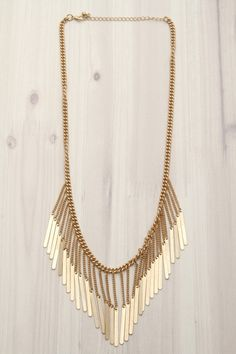 First & Chic   Hold Onto Your Dreams - Bib Chain & Bars Necklace - A super stylish gold bib necklace that will never go out of style! Featuring chain details and a striking bib design of dangling bars. Can be work to many different casual settings in an array of outfit styles.