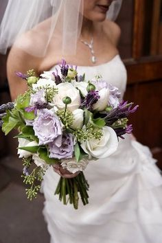 White and Purple bouquet.....but with those flowers that you like with the black in the middle.