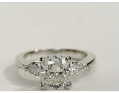 Cushion cut with pear side stones