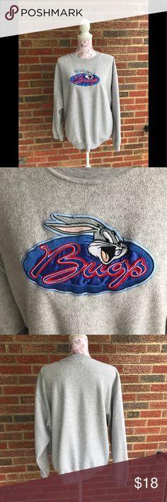 vintage bugs bunny sweatshirt Looney tunes bugs bunny sweatshirt wonderful condition size XL very cozy and warm 75% polyester 25% rayon  Bust 22in  Sleeves 21 1/2in looney tunes Tops Sweatshirts & Hoodies