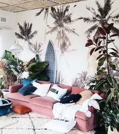 Pink couch all the way! Love the tropical boho vibes in this room