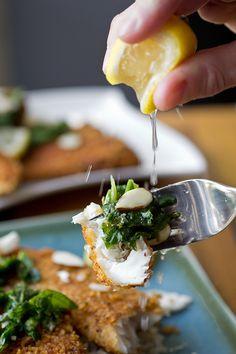 Golden, Crispy Pan-Fried Fish with Lemon, Garlic-Sauteed Greens and Sliced Almonds