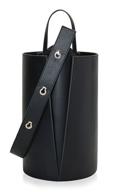 Danse Lente's tote is crafted from smooth leather in a cool bucket silhouette. Detailed with an adjustable keyhole strap, this style opens to a spacious interior that's perfectly sized to hold the essentials.