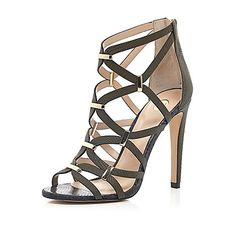 4653adc973e7 I m shopping Black suede caged gold trim sandals in the River Island iPhone  app.