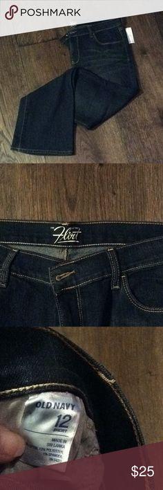 "Old Navy Flirt straight leg dark wash jeans. Old Navy Flirt straight leg dark wash jeans. 29"" inseam and 17"" waist laying flat. Old Navy Jeans Straight Leg"