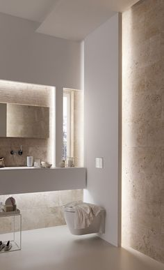 This bathroom has all the appeal of a spa with beautiful lighting, warm tones and floating Geberit wall-hung toilet.