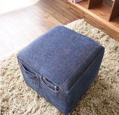 Your Old Jeans Into Furniture ottoman cover Now this is awesome! Love the pockets on the side, perfect for all the different remote controls hidden in the couch. LOLAwesome Awesome may refer to: Diy Ottoman, Ottoman Cover, Jean Crafts, Denim Crafts, Do It Yourself Jeans, Coin Couture, Denim Ideas, Old Clothes, Jeans Denim