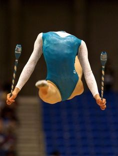 20. This gymnast didn't lose her head in a freak accident: actually, in mid-jump a picture was taken and her head was bent backwards.