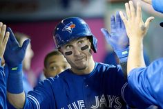 Happy handouts -  Toronto Blue Jays shortstop Troy Tulowitzki celebrates in the dugout after scoring against the Los Angeles Angels during the eighth inning Aug. 21 in Anaheim. - © Richard Mackson/USA TODAY Sports