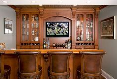 wooden bar in home with flat screen TV