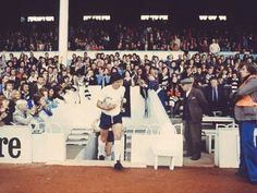 Steve Perryman leads out the team