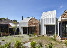 Andrew Maynard has doubled the size of a house in Victoria, Australia by adding a row of skinny gabled blocks.