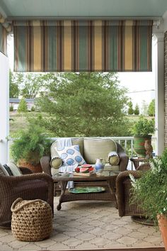 Inspired by Charleston side porches (called piazzas), this outdoor-friendly furniture arrangement provides a great place to socialize with neighbors or to take in the fresh air while reading a book.Tour the Abercorn Place Idea House