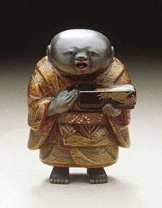 Japan  Fukusuke Doll, late 19th century  Netsuke, Lacquer with mother-of-pearl inlays. LACMA