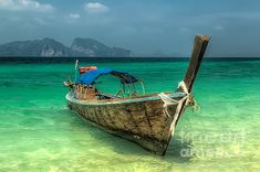 http://fineartamerica.com/featured/thai-boat-adrian-evans.html
