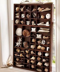 Displaying a seashell collection in a printer tray, adding letters that spell out summer.
