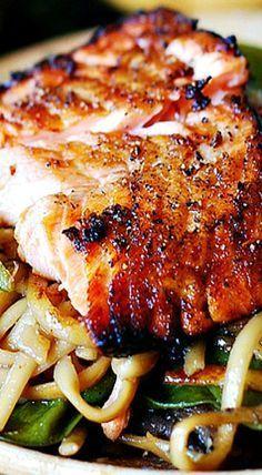 Crispy Asian salmon with stir-fried noodles, pak choi & sugar snap peas