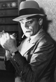 A life long non-smoker in an industry where smoking was prevalent and a near standard in film, Cagney disliked whenever the script called for it.  To get away with not smoking but appearing to do so in film, he enlisted the help of his wife, a life-long smoker, to teach him how to make it look like he was actually inhaling the smoke when he really wasn't.  There are only a handful of films in which Cagney is shown smoking and it's never longer than a few puffs.  Made It Ma!! Top Of The…