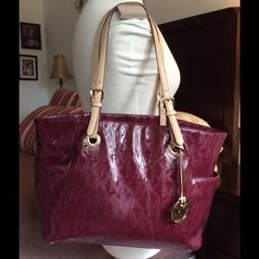 """Gorgeous & Real Michael Kors Plum Bag Gorgeous and Authentic Michael Kors large bag, with code inside, Plum MK plastic, genuine tan leather straps, beige signature MK fabric inside, clean, gold metals. Great Condition, no tears, no scratches, worn twice. 11"""" X 18"""" X 5"""" Large Bag.  -No free shipping. -No holds. -No more discounts for this bag, It is not easy to find good prices for reselling, do not ask for lower prices Please.  Click the listings to see the boutique.  Thanks for your visit…"""