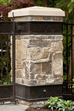 Stone column with custom metal caps  #gates #driveway #iron #custom #gates #automatic #electric #vehicle #seattle #gate #details #design #home #house