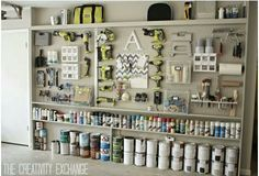 Garage - Paint can/ spray paint storage integrated into shelving.