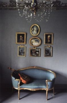 French blue is a gorgeous color for interiors. It is a blue that has a lot of grey in it. French blue is beautiful paired with either silver or golds, especially that chandelier hanging above.