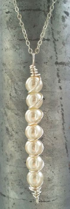 I love the Wire Wrapping on this pearl pendant!!! So easy to do..unique and beau...