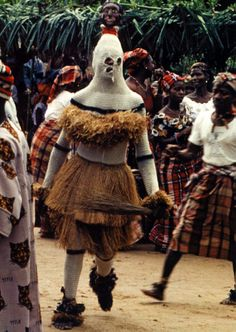 Africa | Nwékpé mask from Ibom village on Nkwo Ekpe Ibom day of the Ikeji. Ibom Village, Arochukwu, September 23, 1988. ||  Nwekpe is a benign (i.e., not aggressive) type of mask with an anthropomorphic headdress.  | ©Eli Bentor; African Arts, Vol 38, No 4 (Winter, 2005)