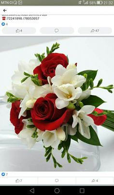 This bouquet has three sensational roses surrounded by beautiful mixed greenery and matching ribbon. This bouquet has three sensational roses surrounded by beautiful mixed greenery and matching ribbon. Red Flower Bouquet, Prom Bouquet, Red Bouquet Wedding, Diy Bouquet, Homecoming Flowers, Prom Flowers, White Flowers, Simple Flowers, Red Roses