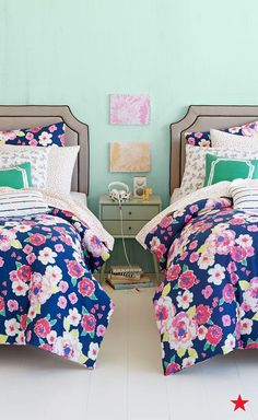 This colorful floral bedding will have you making your bed— and making mom…