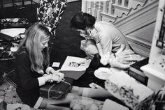 Jackie Kennedy looking at a portrait of her late husband