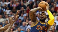 LeBron James - without his trademark headband - takes a shot for the Cleveland Cavaliers