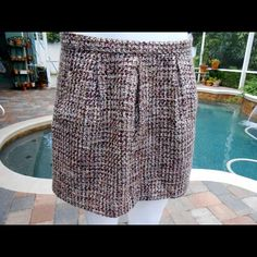 **Markdown**! Multi-colored Tweed Mini Skirt This tweed skirt is fully lined, has side pockets, and closes with a side zipper with a hook and eye closure. Very soft and beautiful! GAP Skirts Mini