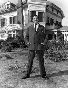 Gomez Addams, played by John Astin, stands outside 21 Chester Place in Los Angeles for a publicity photo. A single scene of this real Los Angeles mansion -- in the West Adams district, no less -- was filmed, for the pilot.