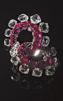 A PAIR OF RUBY AND DIAMOND EAR CLIPS BY BHAGAT.