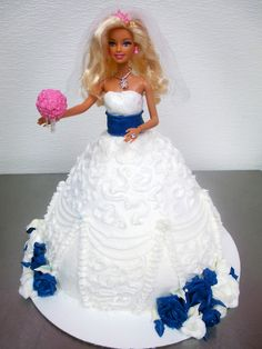 Barbie wedding dress cake! Completly made of cake and frosting, except the Barbie. Adorable! From Cupcakes & More