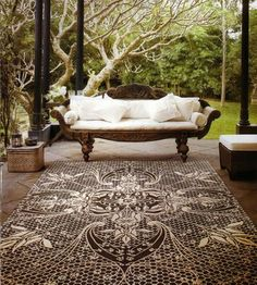 Outdoor rug with porch sofa to relax.. | for more indoor/outdoor living ideas, visit www.cdgdesign.com