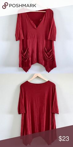 """Ruby Red Ruched Pocket Asymmetric Blouse Ruby Red Ruched Pocket Asymmetric Blouse  Asymmetrical, 1/2 sleeve, ruched pocket, open flap v-neck, rayon/spandex blouse.   New. Sizes 2XL.  Bust: 43""""  Length: 27.5""""  Shoulder: 16"""" Sleeve: 15"""" Tops Blouses"""