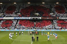Nov 10 Rangers and Peterhead teams observe a minutes silence before kick off at Ibrox Stadium.  Home to Glasgow Rangers Football Club, Scotland