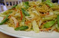 Pancit Canton (Filipino egg noodles)....1 cup pork & 1 cup chicken cooked, cut in strips---1 cup shrimp, shelled---2 cups cabbage, cut in strips--1 cup chicaro (sweet peas)---1 medium carrot, cut into strips--1 oinion, chopped---4 cloves garlic, crushed---soy sauce---salt & pepper--cooking oil---lemons---1 package Pancit Canton (egg noodles)---2 cups chicken broth......(a little work, but so, so worth it)
